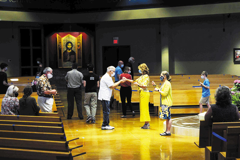 Parishes welcome their congregations back to Mass