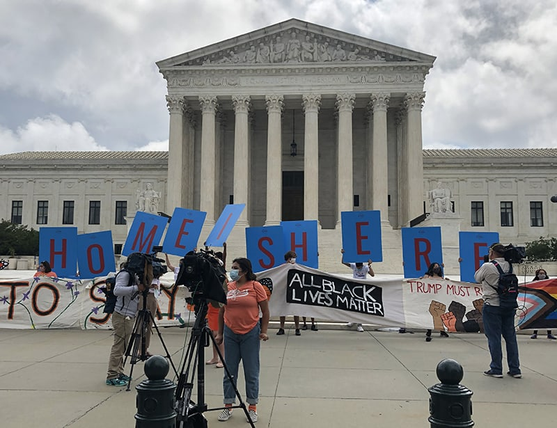 Armed with prayers and signs, young immigrants hail high court's decision
