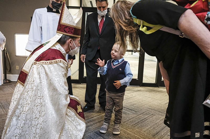 Miracle child attends Chrism Mass