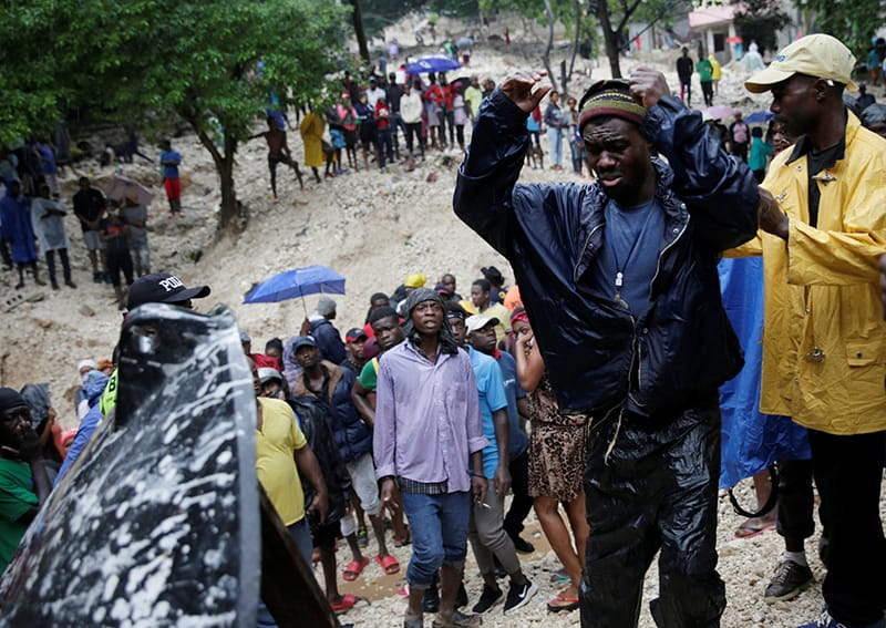 At least 12 dead as tropical storm lashes Haiti, Dominican Republic